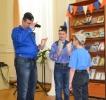 Выступление семьи Садовниковых: чтение по ролям отрвка из книги В. П. Крапивина «Оруженосец Кашка»